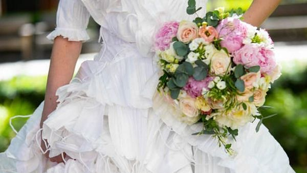 This wedding dress is made from 1,500 discarded face masks