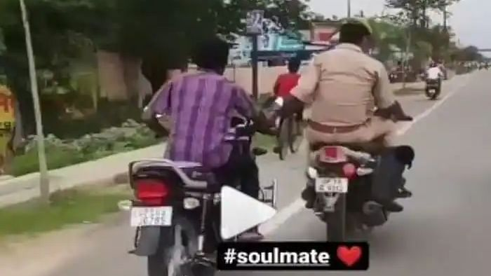 Viral Video: Cop rides to police station while holding criminal's hand