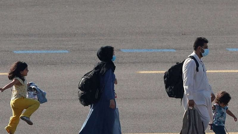 Afghan girl skips on Belgium Airport tarmac, Twitter says, 'Best picture this year'