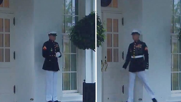 White House Marine gets scared by thunderclap, jumps and then very slowly leaves