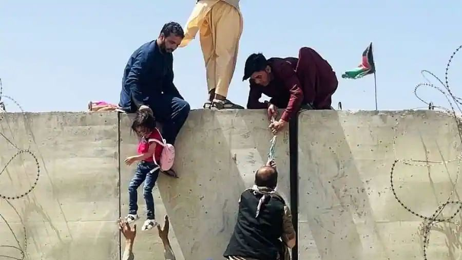 Heartbreaking: Desperate Afghan mothers throw children over Kabul airport fence in bid to escape Taliban