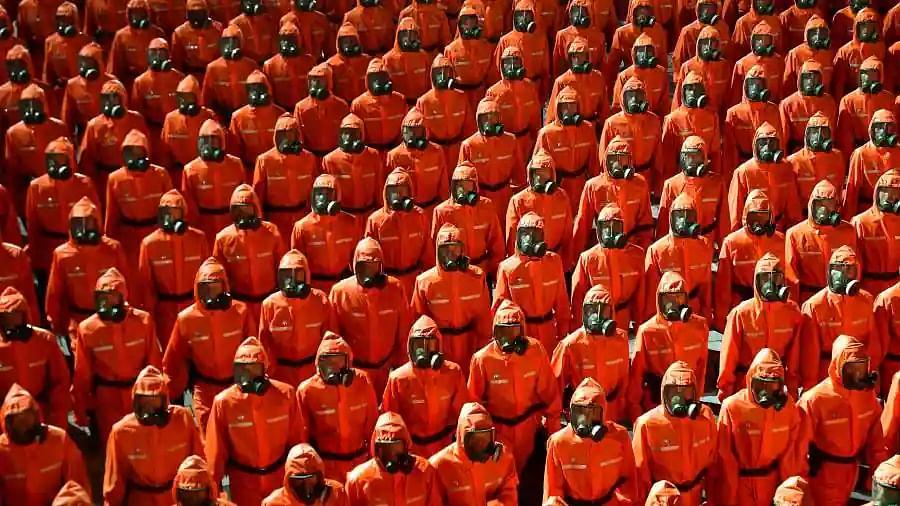Coronavirus effect: North Koreans parade on National Day wearing hazmat suits