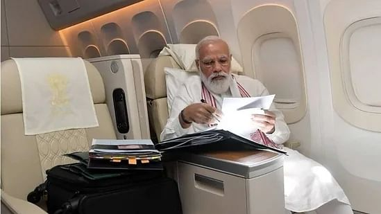 PM shares pic on way to US, says 'long flight means opportunity to go through file work'