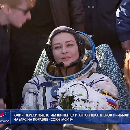 Russian filmmakers land after shooting first movie in space