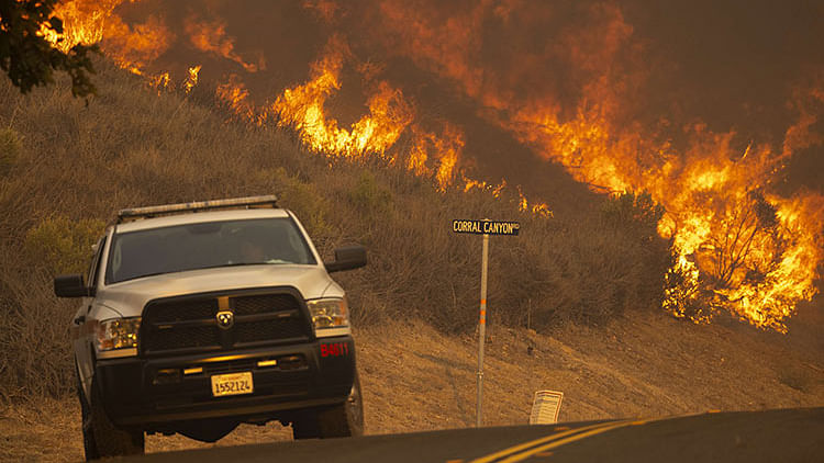 California wildfire shuts highway, forces evacuations