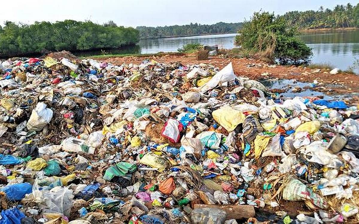Solid waste from Padubidri Gram Panchayat limits found dumped on the northern bank of the Shambhavi in Hejmadi village in Udupi district.