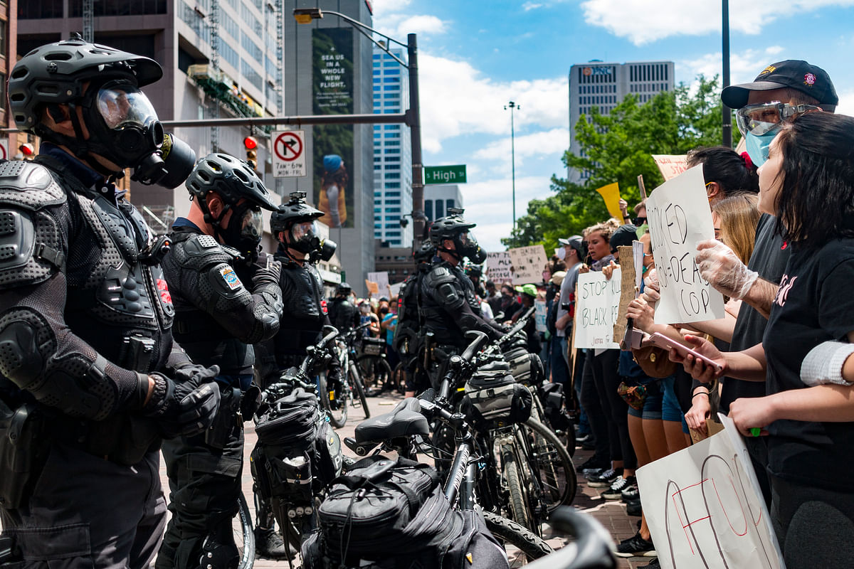 Protesters and Columbus police officers in riot gear confront one another at the intersection of Broad and High Street on May 30, 2020. The riot gear uniforms officers wear during civil unrest do not accommodate body cameras because the gear was purchased prior to the Division's implementation of the cameras in 2016.