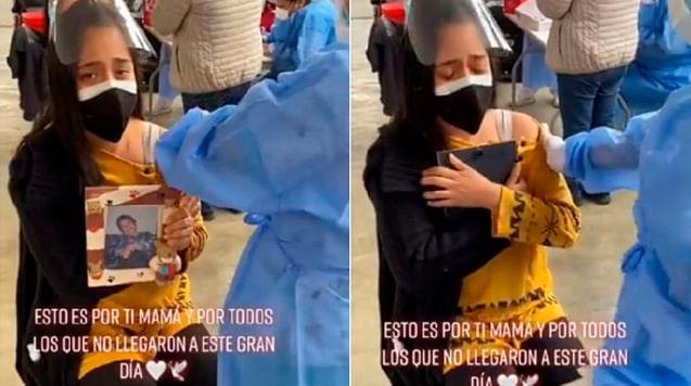 Joven se vacuna abrazada al retrato de su mamá y rompe en llanto [Video]