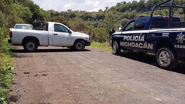 Hallan cadáver en sembradíos inundados de Michoacán