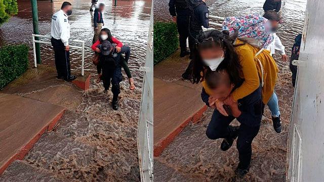 Auxilian a niños atrapados en una escuela inundada en Morelia