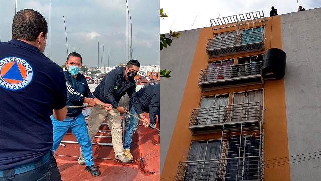 "Retiran tinaco ""equilibrista"" del balcón de un departamento en Iztacalco"