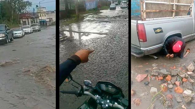 """Lluvia desata caos en Morelia; baches """"ocultos"""" averían coches"""