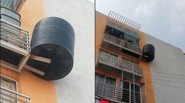 Instala tinaco en 5to piso y lo refuerza con lazo para que no se caiga