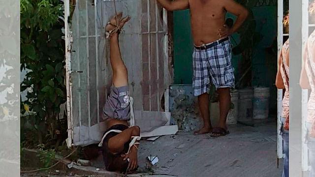 Someten y exhiben colgado a presunto ladrón en Quintana Roo