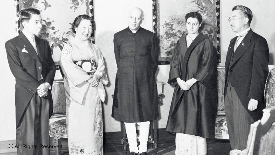 ROYALTY—Prime Minister Jawaharlal Nehru (centre) at the Imperial Palace in Tokyo with his host, Emperor Hirohito (right) in 1957. Also seen are (from left) Crown Prince Akhihito, Empress Nagasako and Indira Gandhi.