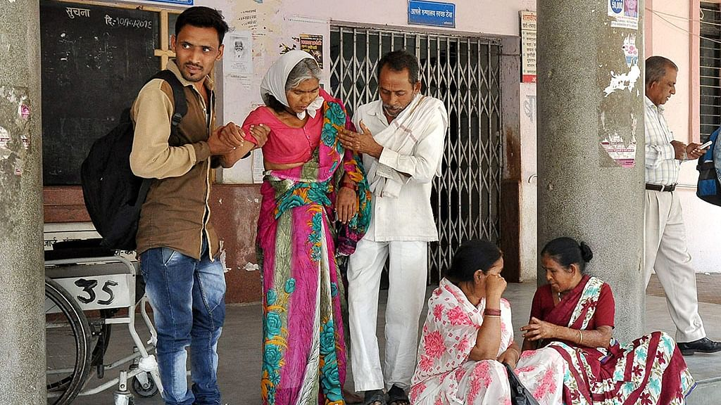 Patients wait outside the OPD at GMC Hospital as resident doctors were on a strike in Nagpur on Friday, March 24