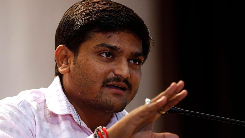 Deputy Chief Minister Nitin Patel's supporter slaps Hardik Patel