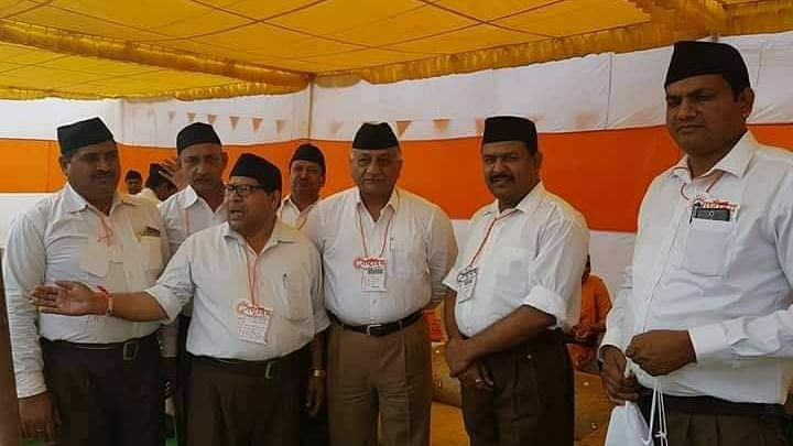 After olive green, former Army Chief Gen VK Singh dons RSS uniform