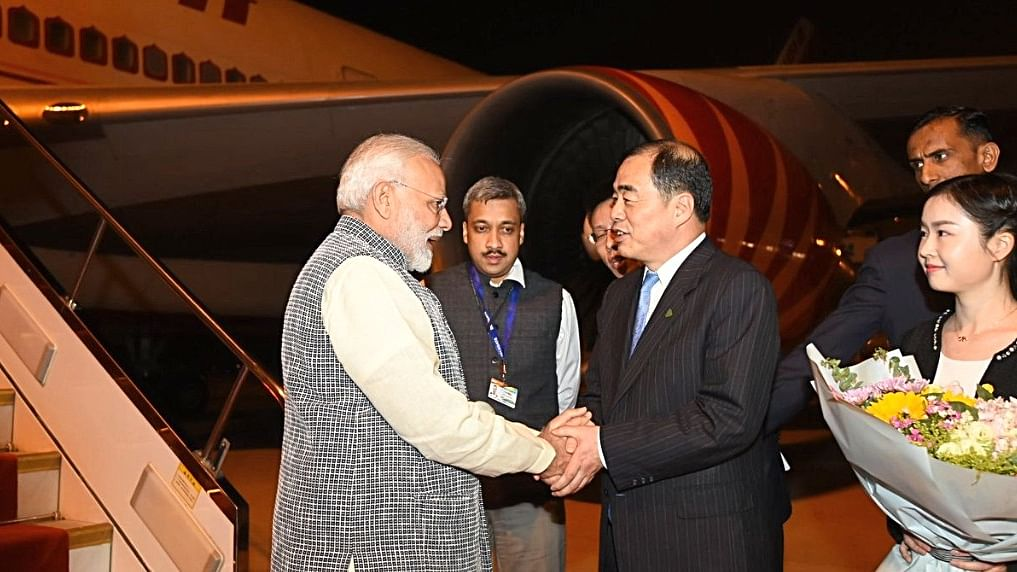 PM Modi, President Xi meet under shadows in Wuhan, China