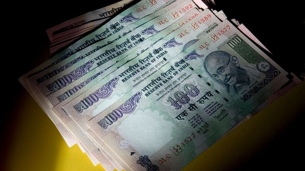 Rupee crashes to over 8-month low of 71.81 against USD