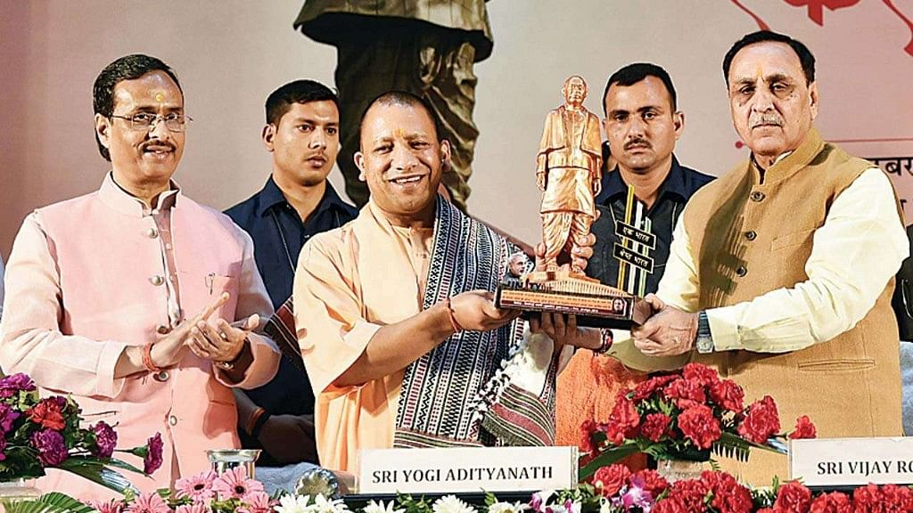 Rupani, Yogi get together to cover up attacks on Biharis and UP wallahs in Gujarat
