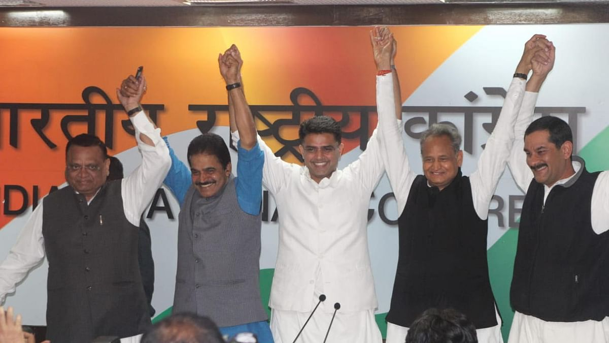 Senior Congress leader KC Venugopal with Sachin Pilot and Ashok Gehlot after the announcement of their names as Rajasthan CM and deputy CM