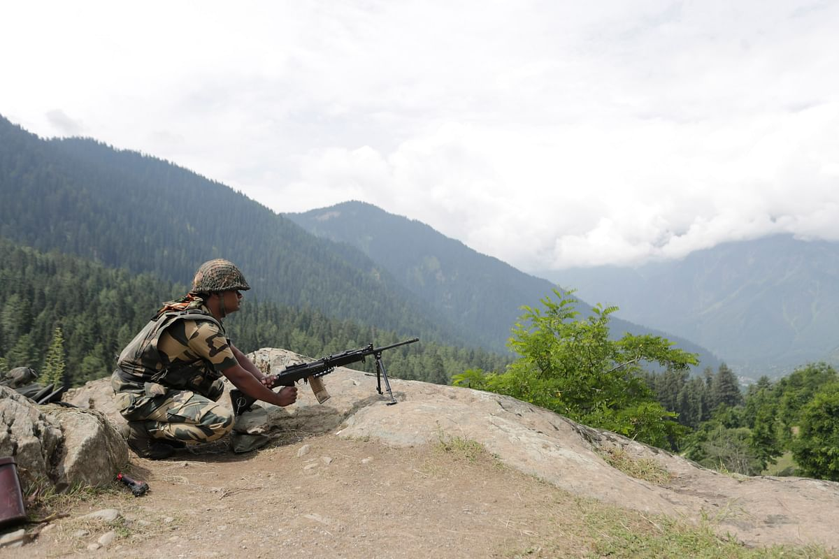 A Border Security Force soldier stands guard on a mountain on July 11, 2017 in Chandanwari, around 116 kilometers south of Srinagar in Jammu and Kashmir.