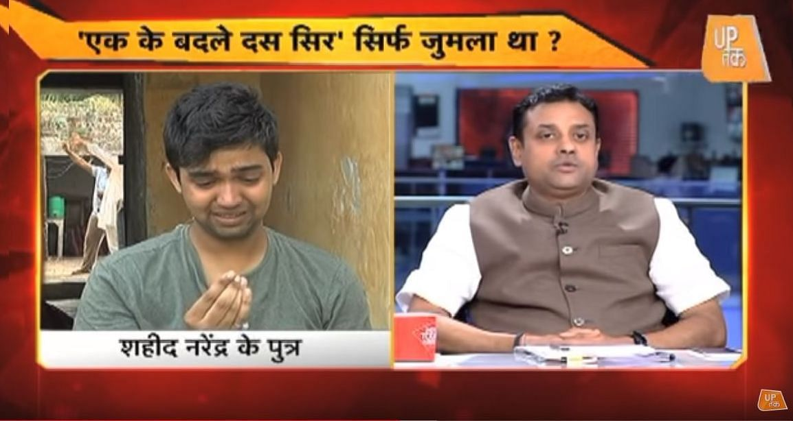 A screengrab of the panel discussion on Aaj Tak showing Mohit Dahiya and Sambit Patra.