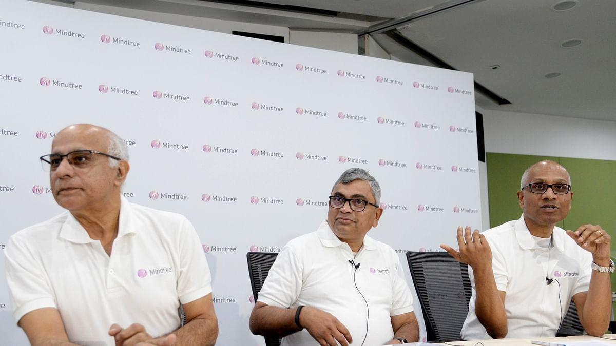 Mindtree Co-founder Subroto Bagchi, Executive Chairman Krishnakumar Natarajan and CEO, MD and Executive Director Rostow Ravanan during a press conference in Bengaluru (Photo: IANS)