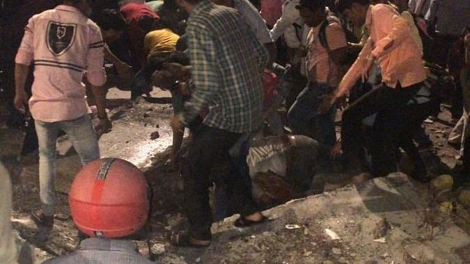 At least four dead, 32 injured as foot overbridge collapses near Mumbai CST