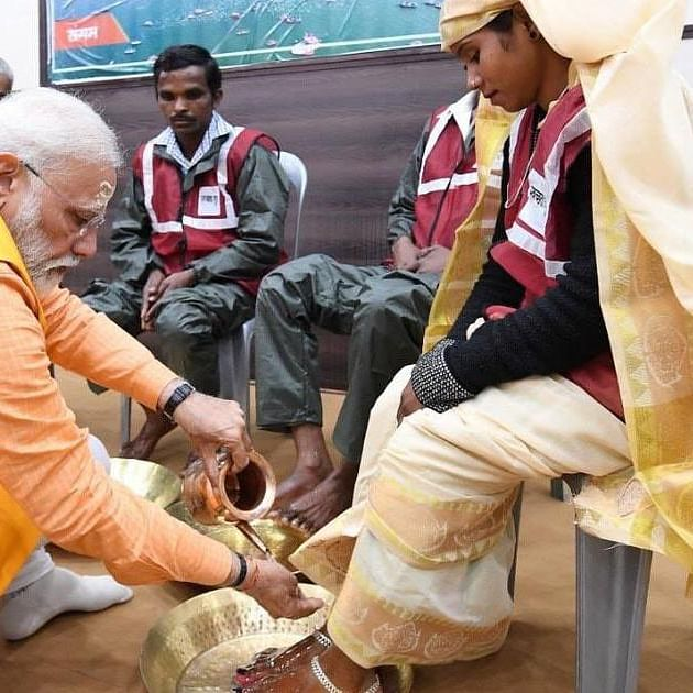 Modi's stunt of washing the feet of sanitary workers points to glorification of caste system