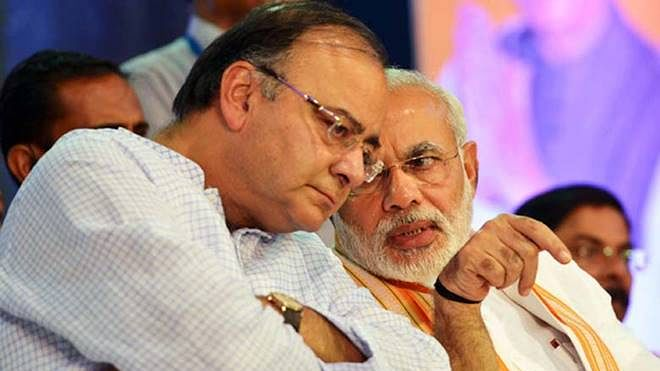 Stung by Rs 80,000 crore shortfall in tax collections, Modi govt forces PSUs to cough up more money
