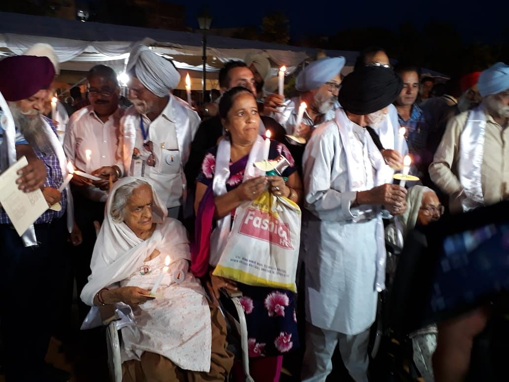 Senior citizens, freedom fighters and family members of the martyrs of Jallianwala Bagh massacre taking part in the candle march (Photo by Pramod Pushkarna)