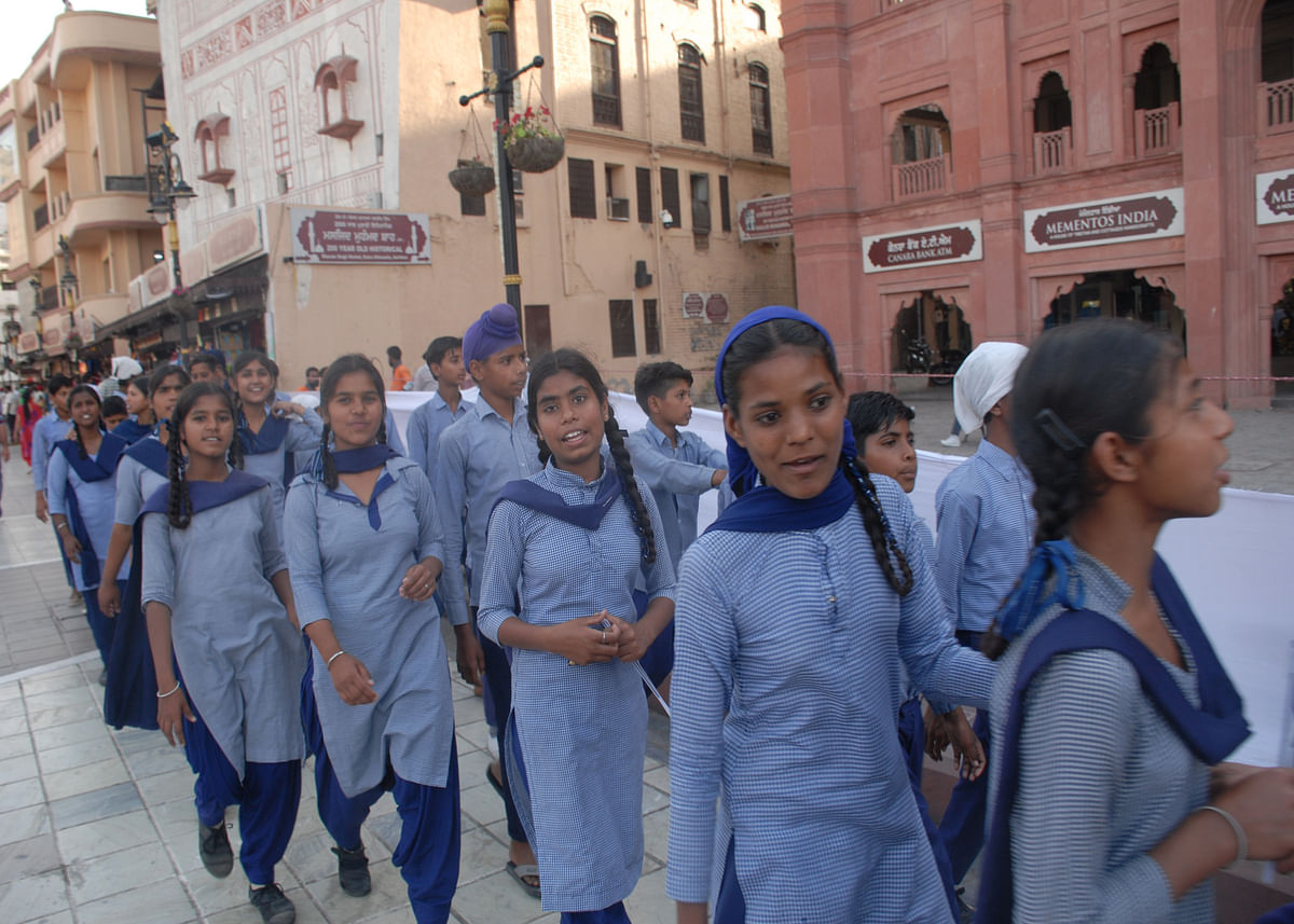 School children walking to take part in the candle march (Photo by Pramod Pushkarna)