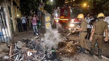 Firefighters dousing flames in Kolkata after BJP supporters allegedly clashed with Trinamool supporters during Amit Shah's road show on Tuesday/Twitter