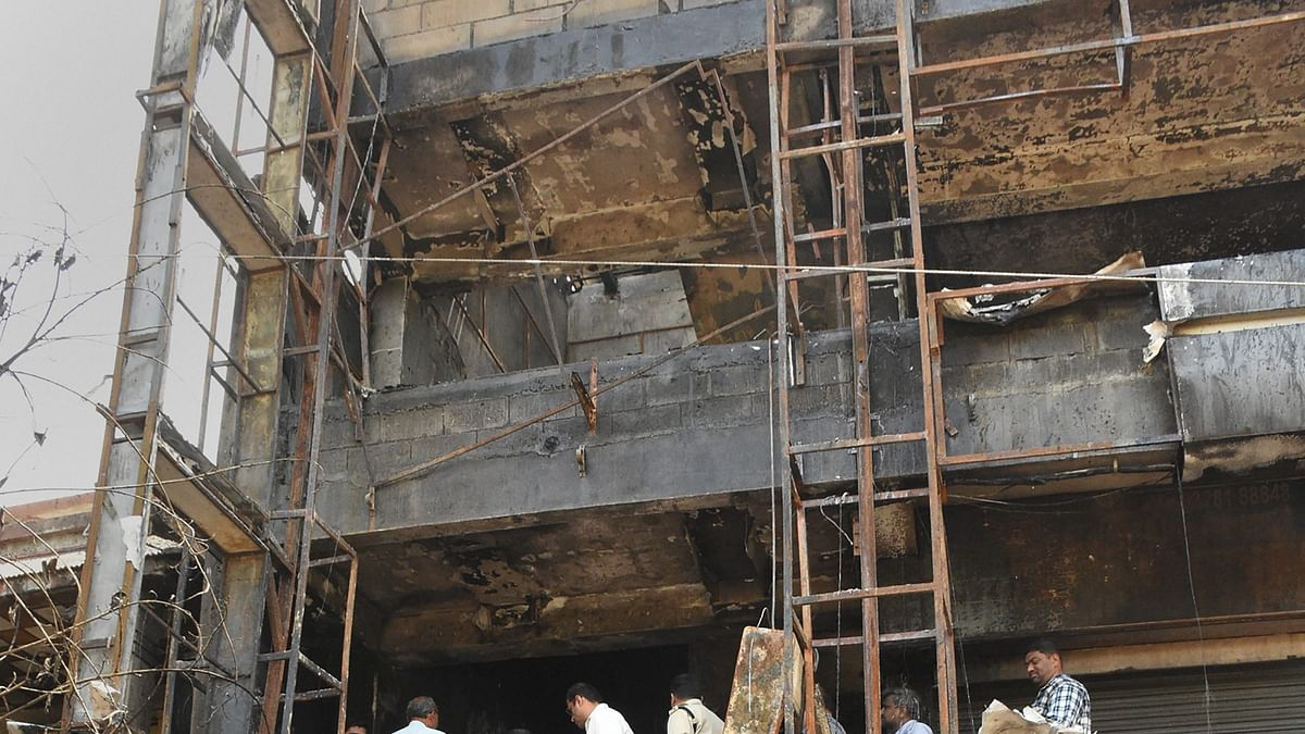 PM's Gujarat Model failed to rein in  unsafe buildings in Surat, death of 20 students