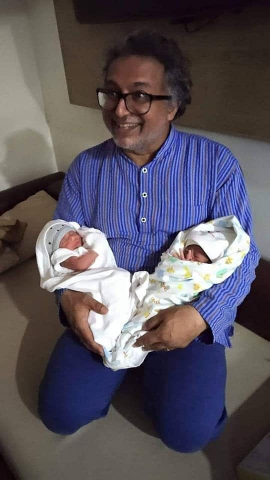 Desmond Coutinho with the newborn twins (Facebook)