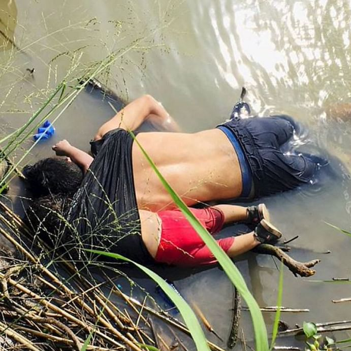 The bodies of Salvadorian migrant Oscar Alberto Martinez Ramirez and his daughter Valeria are seen after they drowned in the Rio Bravo river while trying to reach the United States (Social Media/Twitter)