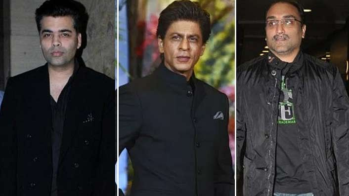 From Left to right  (Karan Johar, Shah Rukh Khan and Aditya Chopra)