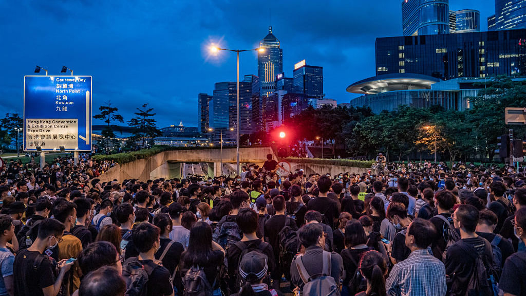 Silent sit-in escalates as Hong Kong protesters gather outside parliament and police HQ after end of ultimatum