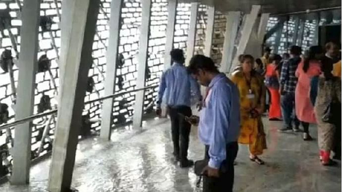 WATCH| Visitors walk through puddles as water drips from ceiling at  Statue of Unity