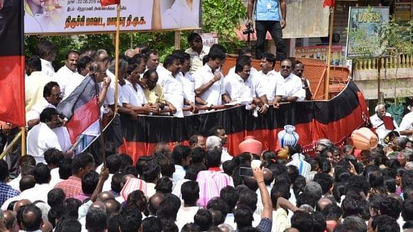 DMK protests, AIADMK seeks rain Gods' blessings