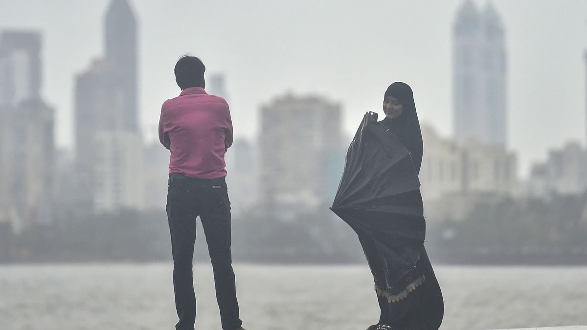 People at Marine Drive during Monsoon showers in Mumbai (PTI)