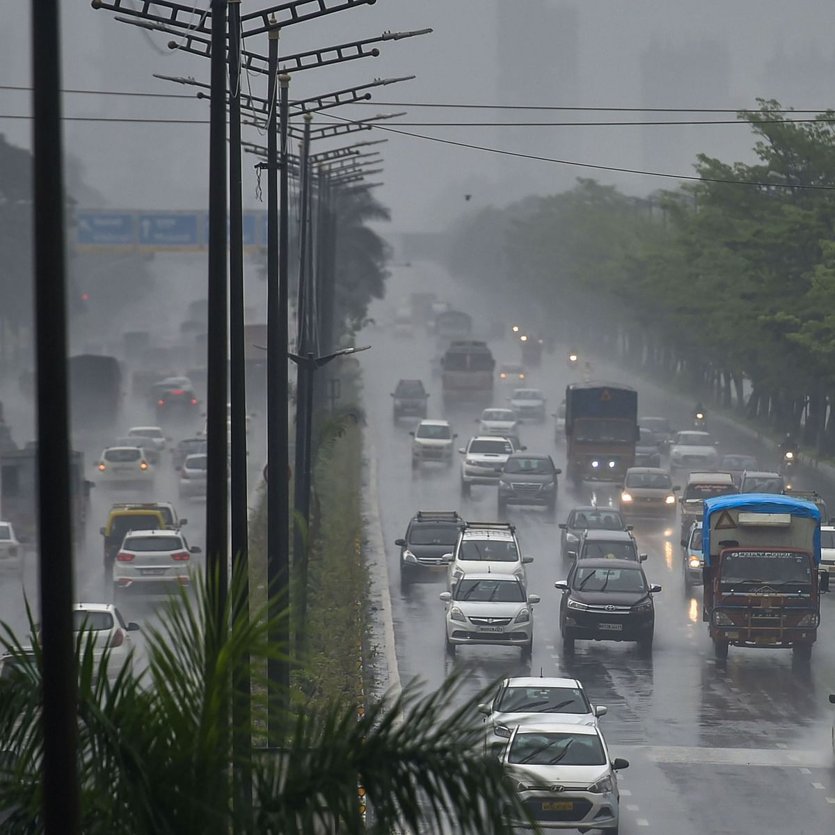Vehicles ply on the Eastern Express Highway during heavy monsoon rainfall, in Mumbai (File Photo) (PTI)