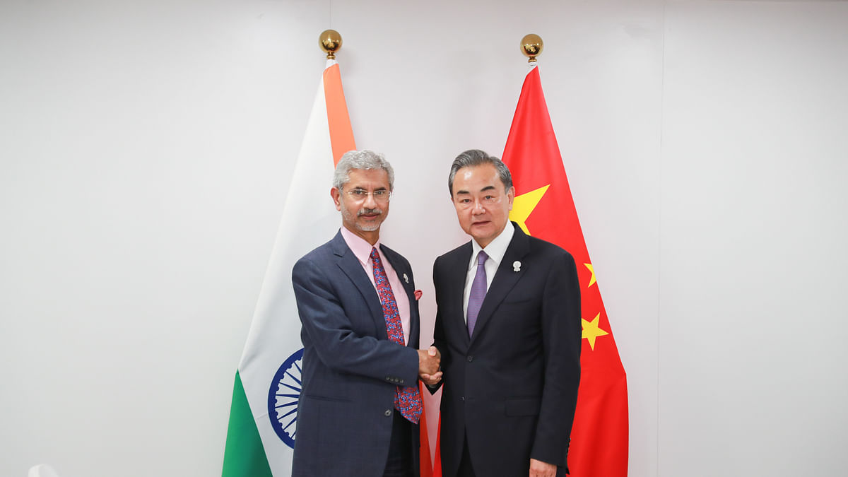 Chinese State Councilor and Foreign Minister Wang Yi (R) meets with India's Minister of External Affairs Subrahmanyam Jaishankar (IANS Photo- file)