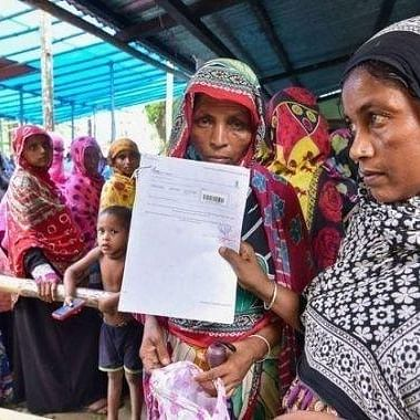 A file photo of people thronging an NRC verification centre in Assam with their documents to prove their citizenship.