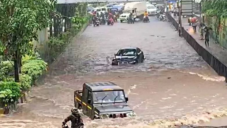 Clip on Bolero driving past Jaguar in Mumbai rains goes viral