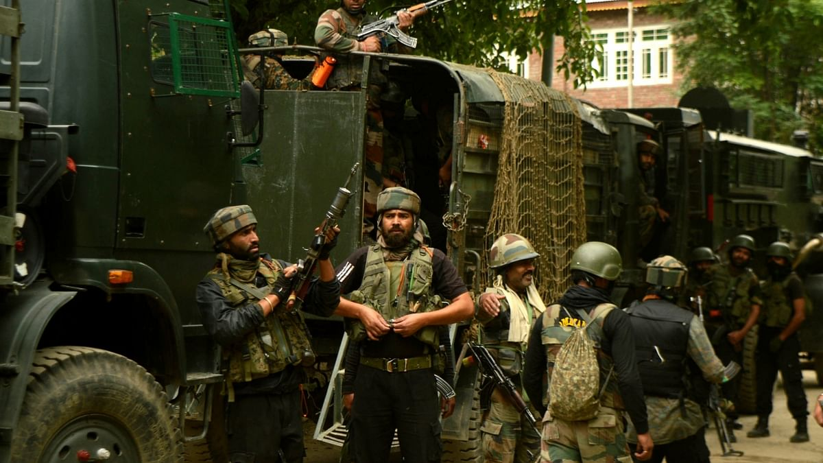 Indian soldiers gearing up for a gunfight