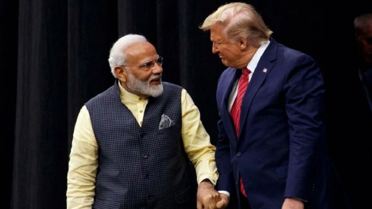 What's cooking? PM Modi with President Trump at the 'Howdy Modi' event in Houston, US. American natural gas company Tellurian was one of the sponsors of the event.