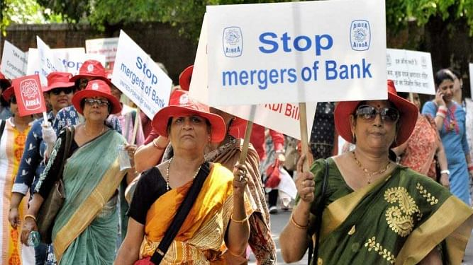 Bank employees protest against the mergers (PTI photo).